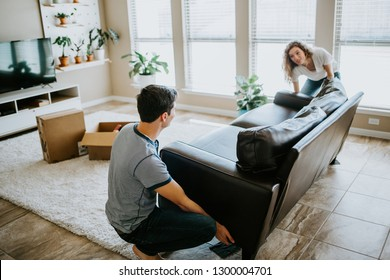 Young Couple Unpacking into First Home