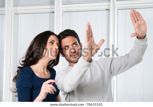 Young couple valuate and dreaming their new house