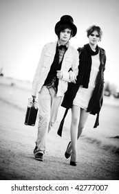 Young couple walking. Contrast black and white colors.