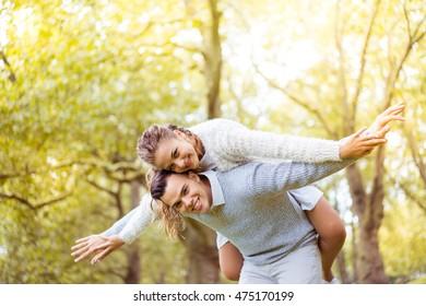 Young couple walking, Hyde Park, London: sunset colour tone