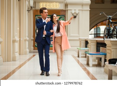 A young couple is walking in the mall