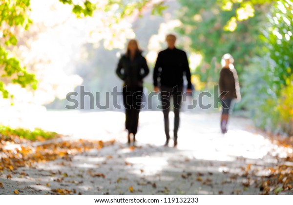 Young couple walking in the park. Blurred motion.