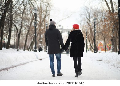 Young couple walking through the winter city