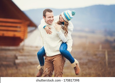 Young couple walking together while enjoying a day in the park