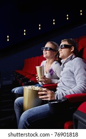 Young couple watching a movie in the cinema
