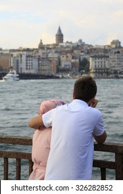 Young couple watching sea,Istanbul,Turkey.