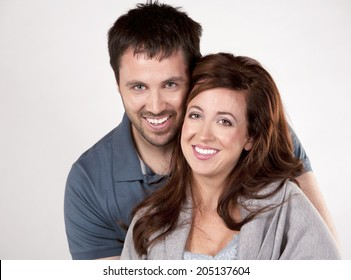 young couple wearing casual outfits on white background