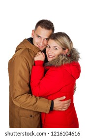Young couple wearing red and brown winter parka jacket posing on isolated background - Seasonal fashion clothing