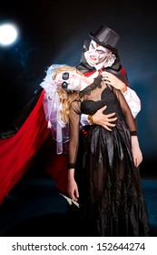 young couple wearing  as  vampire and  dead bride. Halloween