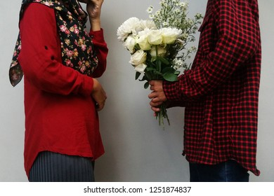 Young couple with white flower bouquet