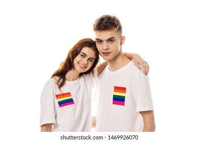 young couple in white shirts on an isolated background flag homosexual