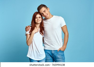 young couple in white t-shirts