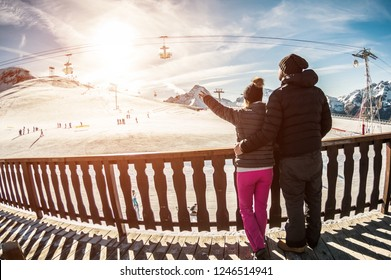 Young couple in winter vacation at snow resort mountain - Skiers tourists relaxing in ski slope chalet - Travel, holiday, relationship and sport concept - Focus on heads - Fisheye lens distortion