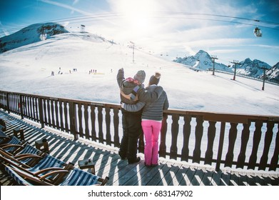 Young couple in winter vacation at snow resort mountain - Skiers tourists relaxing in ski slope chalet - Travel concept - Soft focus on him - Contrast retro filter with fisheye lens distortion