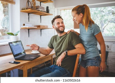 Young couple working on laptop, teamwork
