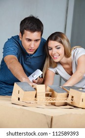 Young couple working together on their future model house