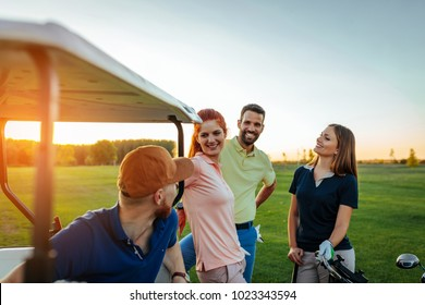 Young couples getting ready to play golf