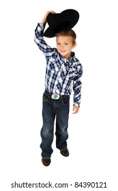 Young cowboy lifting his hat to greet someone