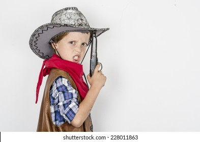 young cowboy on a white background