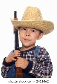 A young cowboy with a toy gun