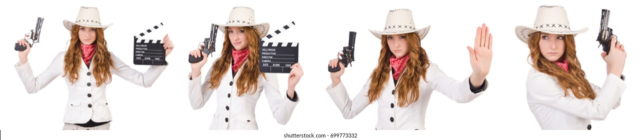 Young   cowgirl with gun  and movie board  isolated on white