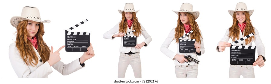 Young   cowgirl  with movie board isolated on white
