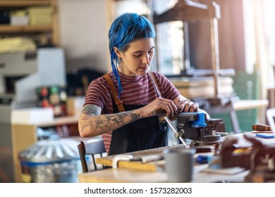 Young craftswoman during her work