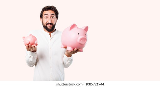 young crazy or mad man, expressive face with a piggy bank
