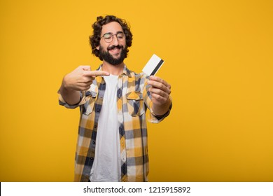 young crazy mad man  fool pose with a credit card. cash or money concept