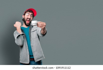 young crazy man with beard and red cap and holding a coffee cup