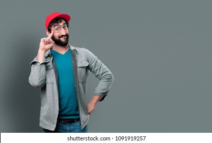 young crazy man with beard and red cap and having an idea. inspiration concept