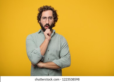 young crazy man with a goofy, dumb, silly look, feeling shocked and confused at a recent realization, not really understanding an idea.