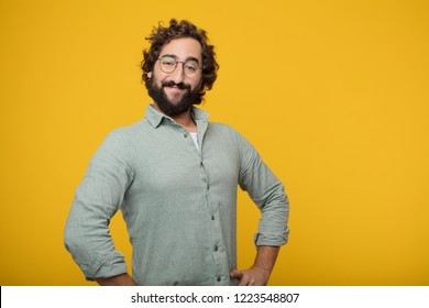young crazy man with a proud, satisfied and happy look, with both hands on hips, as if confidently facing a challenge. Akimbo arms pose with a broad smile.