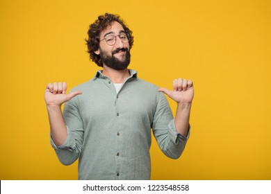 "young crazy man smiling proudly and confidently with arms hands on hips in akimbo pose, happy and sure of success, giving an ""achiever"" look."