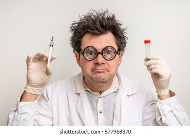 Young crazy scientist performing experiments in laboratory