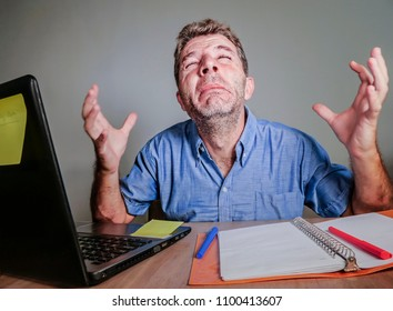 young crazy stressed and overwhelmed man working messy crying desperate with laptop computer feeling exhausted and frustrated in business and work problem and office lifestyle concept