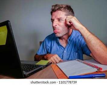 young crazy stressed and upset man working messy at office desk desperate gesturing mad to laptop computer angry and frustrated in business and work problem lifestyle concept