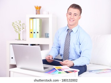 Young creative designer working at home