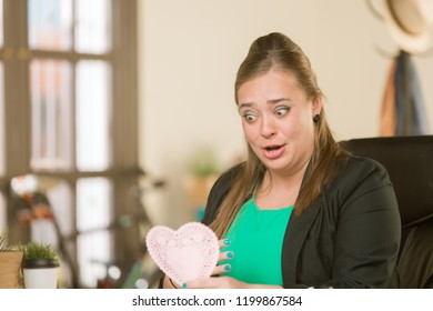 Young creative professional woman reacting to Valentine message