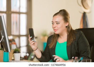 Young creative professional woman in a video chat session
