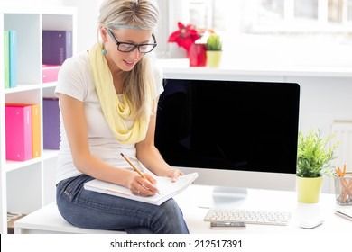 Young creative woman working in the office