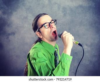 young crooner in green shirt and necktie