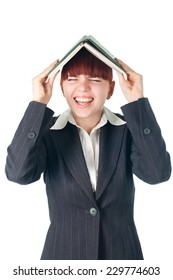 young crying business woman with notebook on the head
