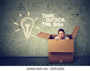 Young curious woman coming out of box isolated on gray info graphic wall background