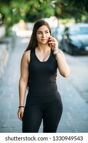 Young curvy woman talking on the phone on street