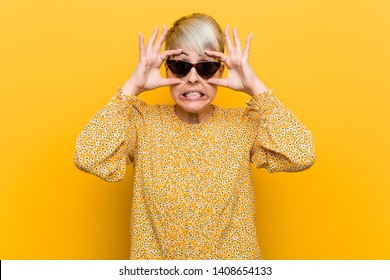 b8ee217800fc Young curvy woman wearing a floral summer clothes keeping eyes opened to  find a success opportunity