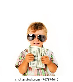 young cute boy holding lot of cash, american dollars isolated close up