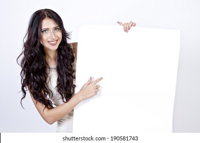 Young cute brown hair pointing her finger on the empty sheet