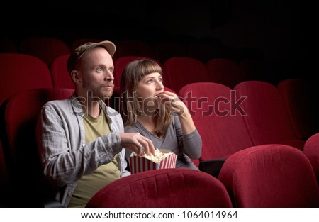 Young cute couple sitting