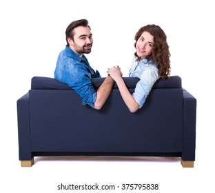 young cute couple sitting on sofa isolated on white background